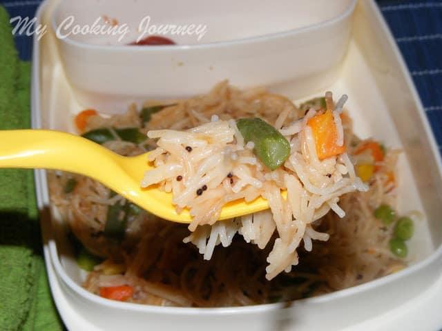 Semiya upma scooped in a fork
