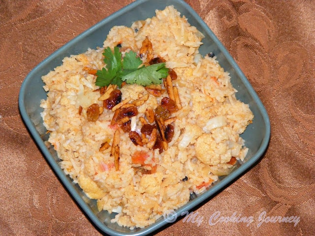 Cauliflower Dum Biriyani in a bowl garnish with cilantro