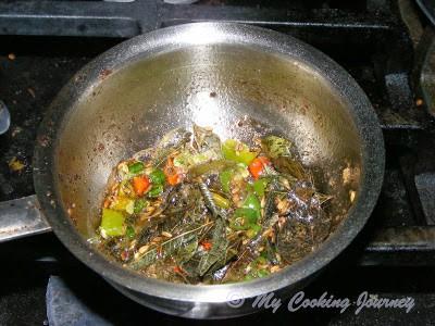 frying the seasoning in a pan