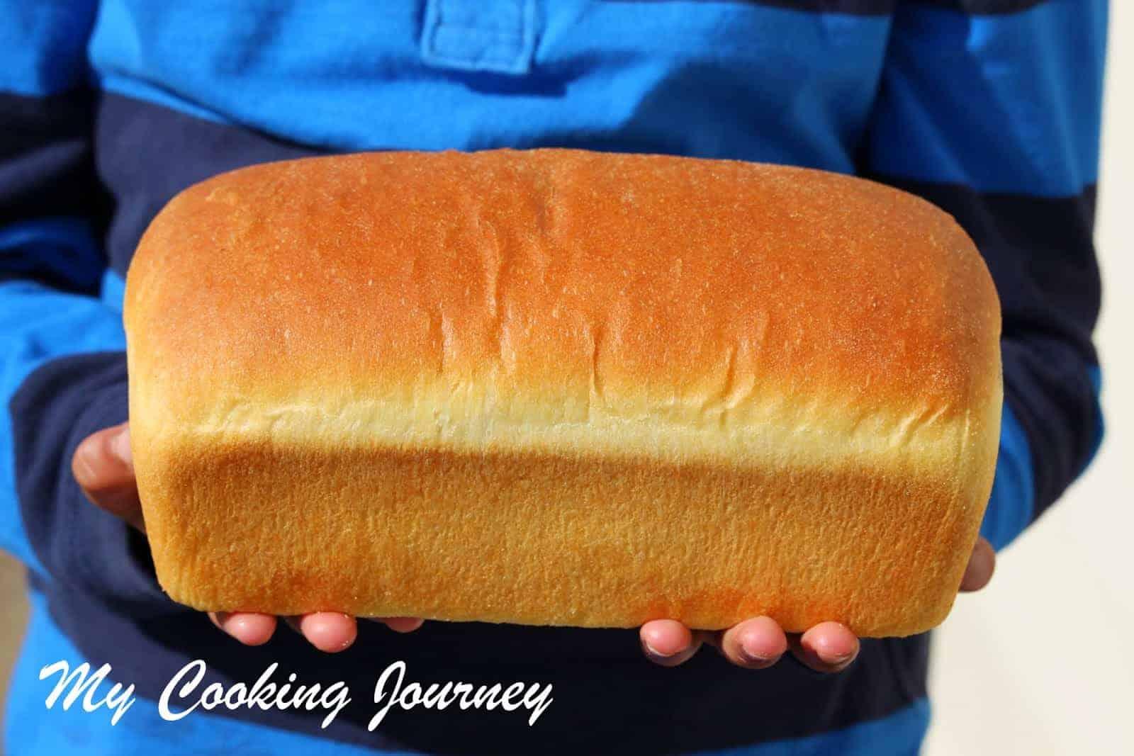 Semolina Bread loaf in hand
