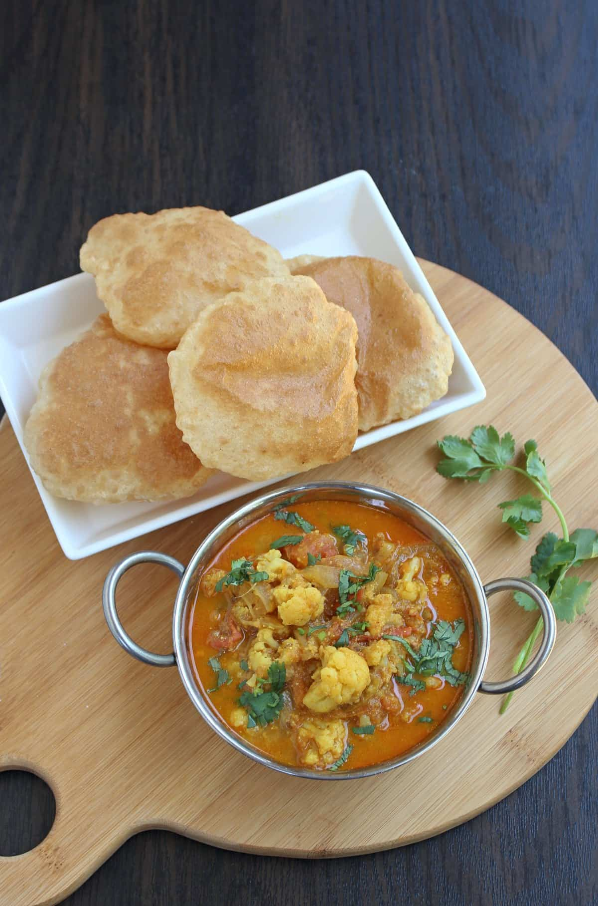 Cauliflower curry / subzi in a bowl with poori